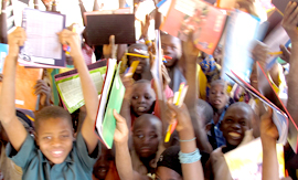 Kids with books in Damana school